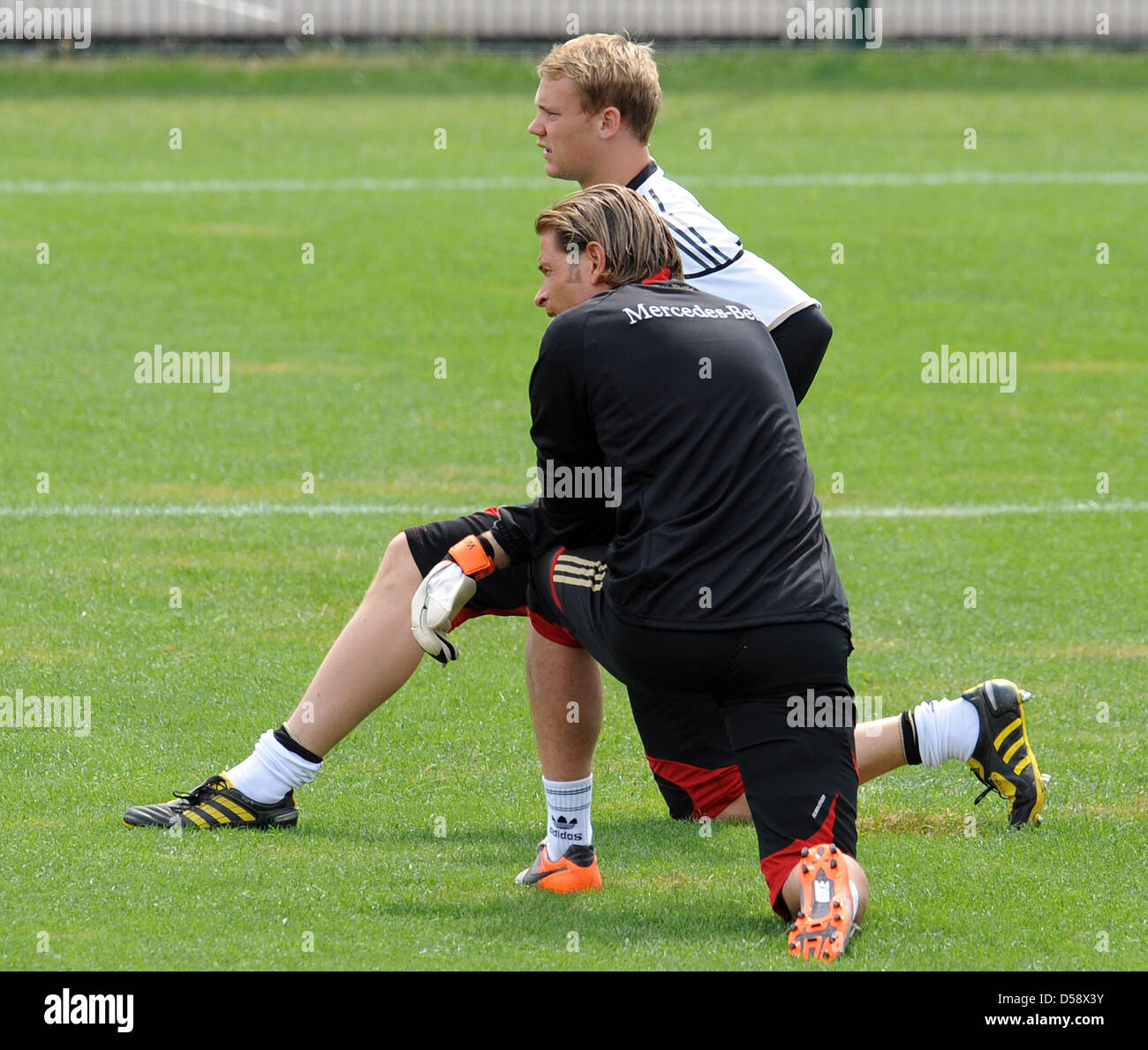German international goalkeepers Manuel Neuer (back) and Tim Wiese warm up during a training session at the training - Stock Image