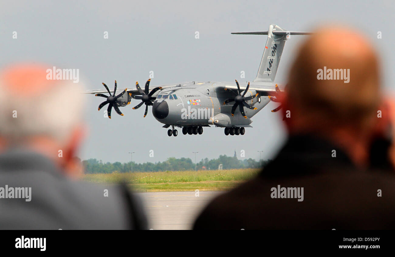 Professtional visitors view a military plane of the type Airbus A400M at the International Aerospace Exhibition Stock Photo
