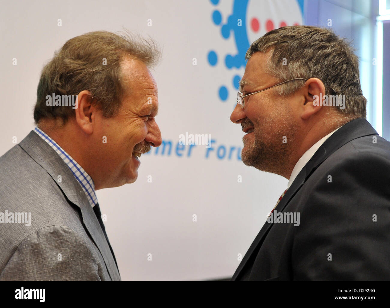 Verdi chairman Frank Bsirske (L) talks to Brandenburg's Interiour Minister Rainer Speer at the 8th Potsdam Forum - Stock Image