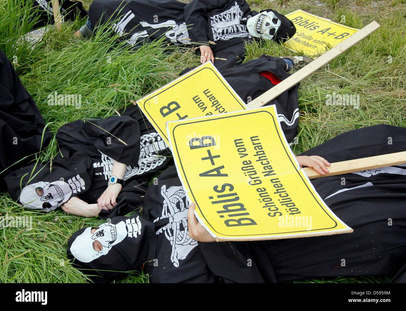 Demonstrators, many of them dressed up as skeltons, lay in front of atomic plant in Biblis, Germany, 12 June 2010. Stock Photo