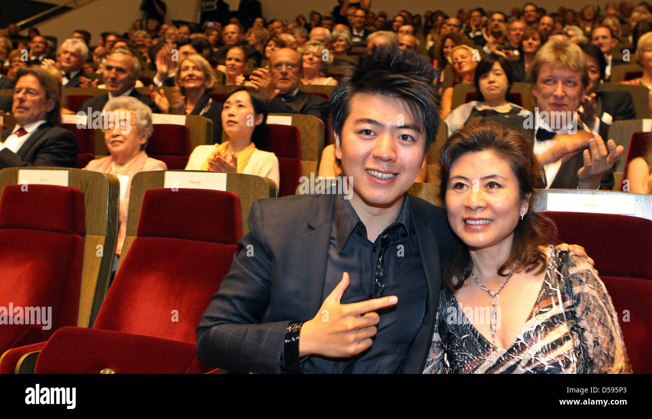 Chinese pianist Lang Lang and his mother Xiocan Zhou sit