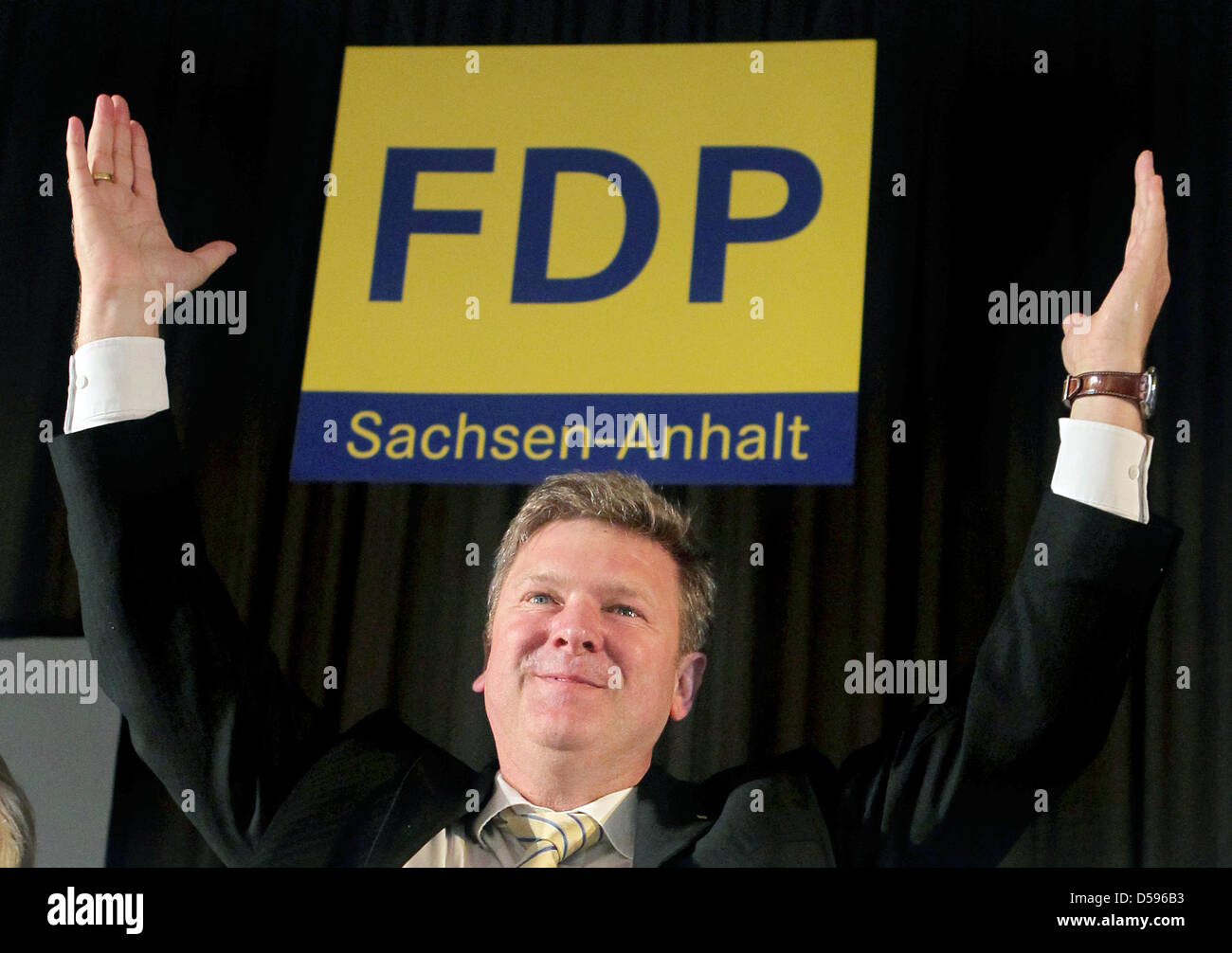 Whip at Saxony-Anhalt's FDP, Veit Wolpert, cheers at the state delegates meeting of the Saxony-Anhalt FDP in Zerbst, Stock Photo