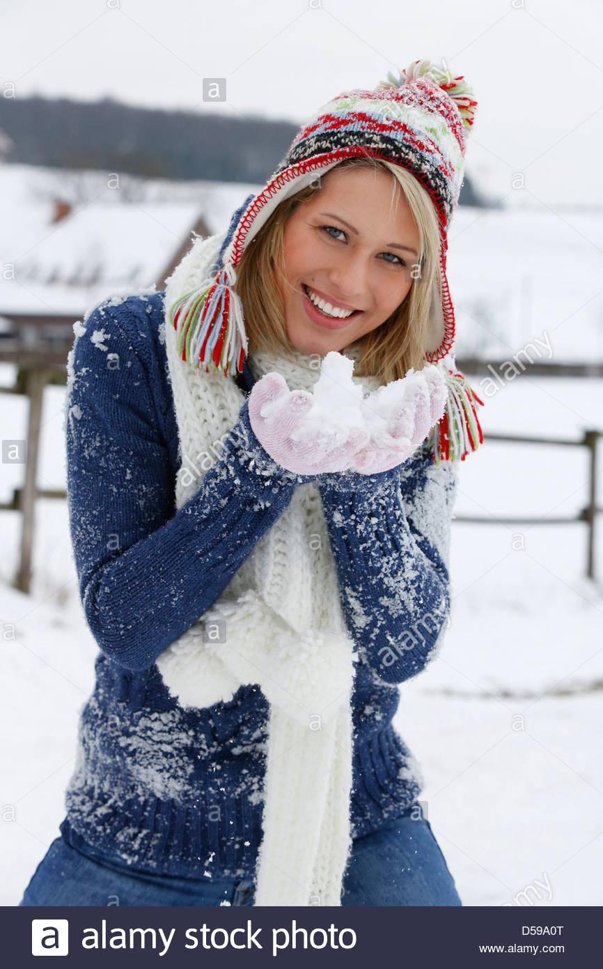 woman take a walk in winter landscape Stock Photo