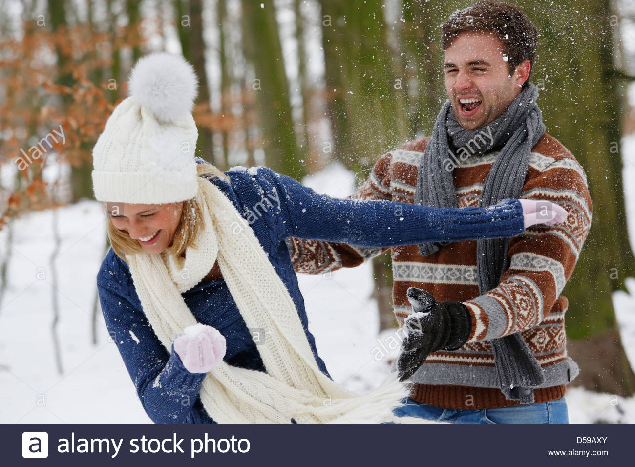 young couple take a walk in winter landscape - Stock Image