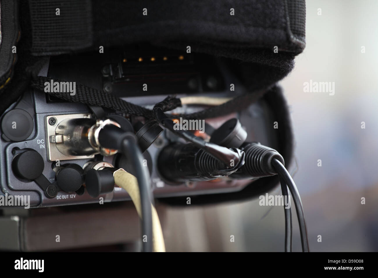 cables connected to a videocamera - Stock Image