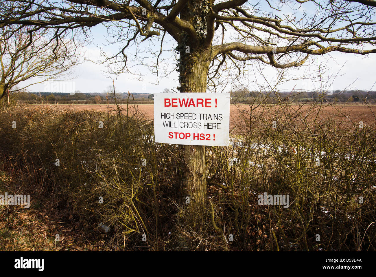 A sign protesting against the HS2 high speed railway line, which will pass through this area of Warwickshire at - Stock Image