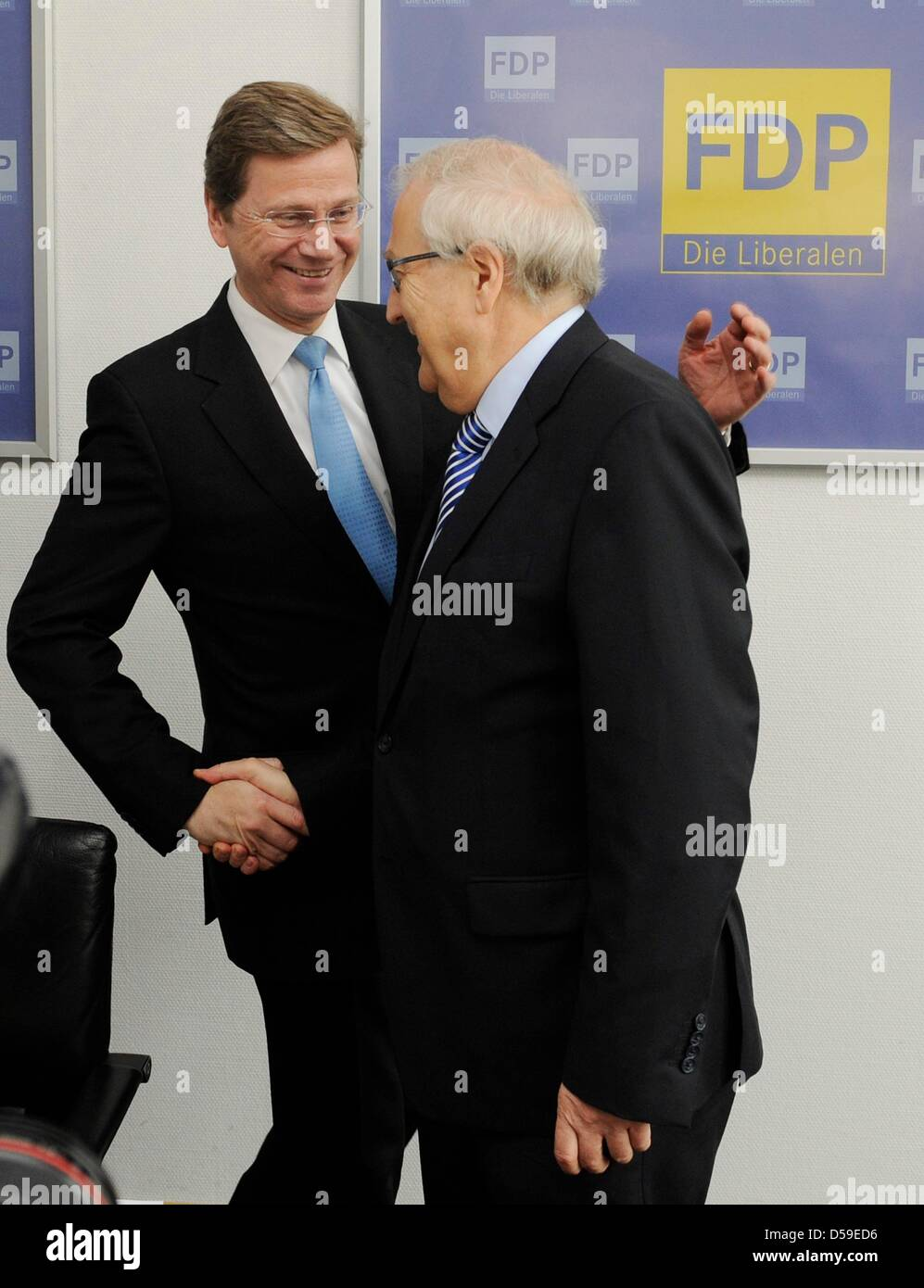 FDP chairman Guido Westerwelle (L) and his deputy Rainer Bruederle greet each other at the party headquarters in Berlin, - Stock Image