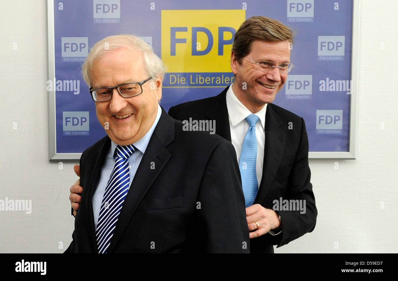 FDP chairman Guido Westerwelle (R) and his deputy Rainer Bruederle greet each other at the party headquarters in Berlin, - Stock Image
