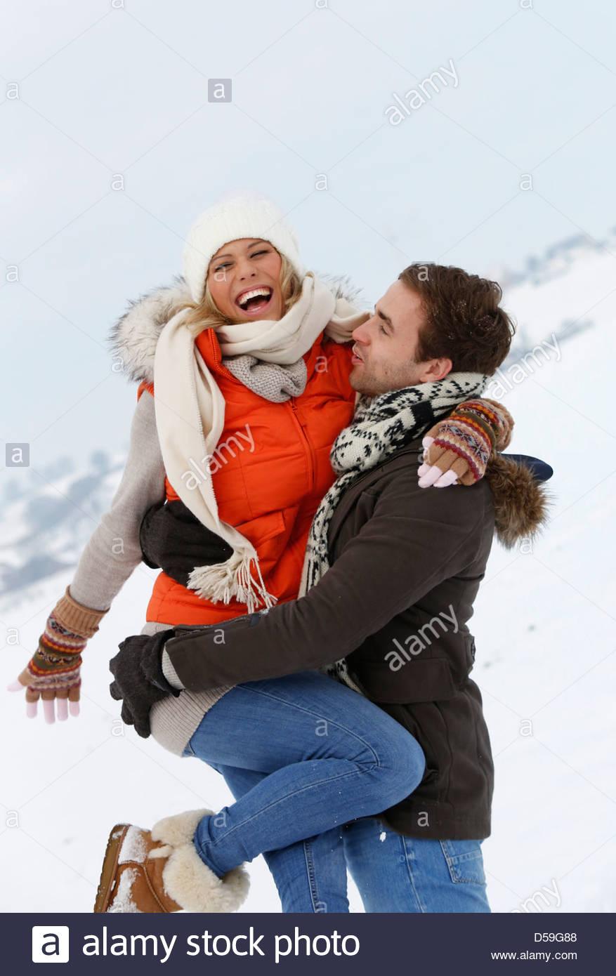 couple in winter landscape Stock Photo