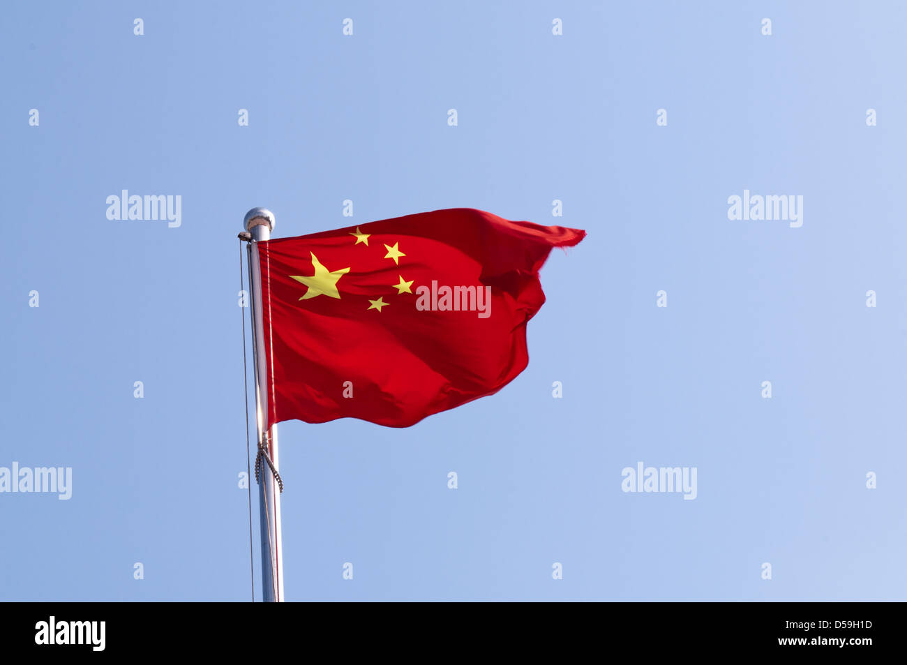 chinese flag on blue sky background - Stock Image
