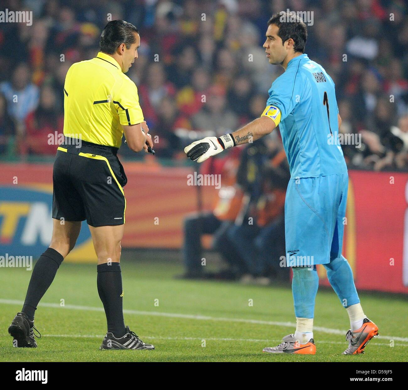 de77bc9b2 Chile s goalkeeper Claudio Bravo gestures towards Mexican referee Marco  Rodriguez during the 2010 FIFA World Cup group H match between Chile and  Spain at ...