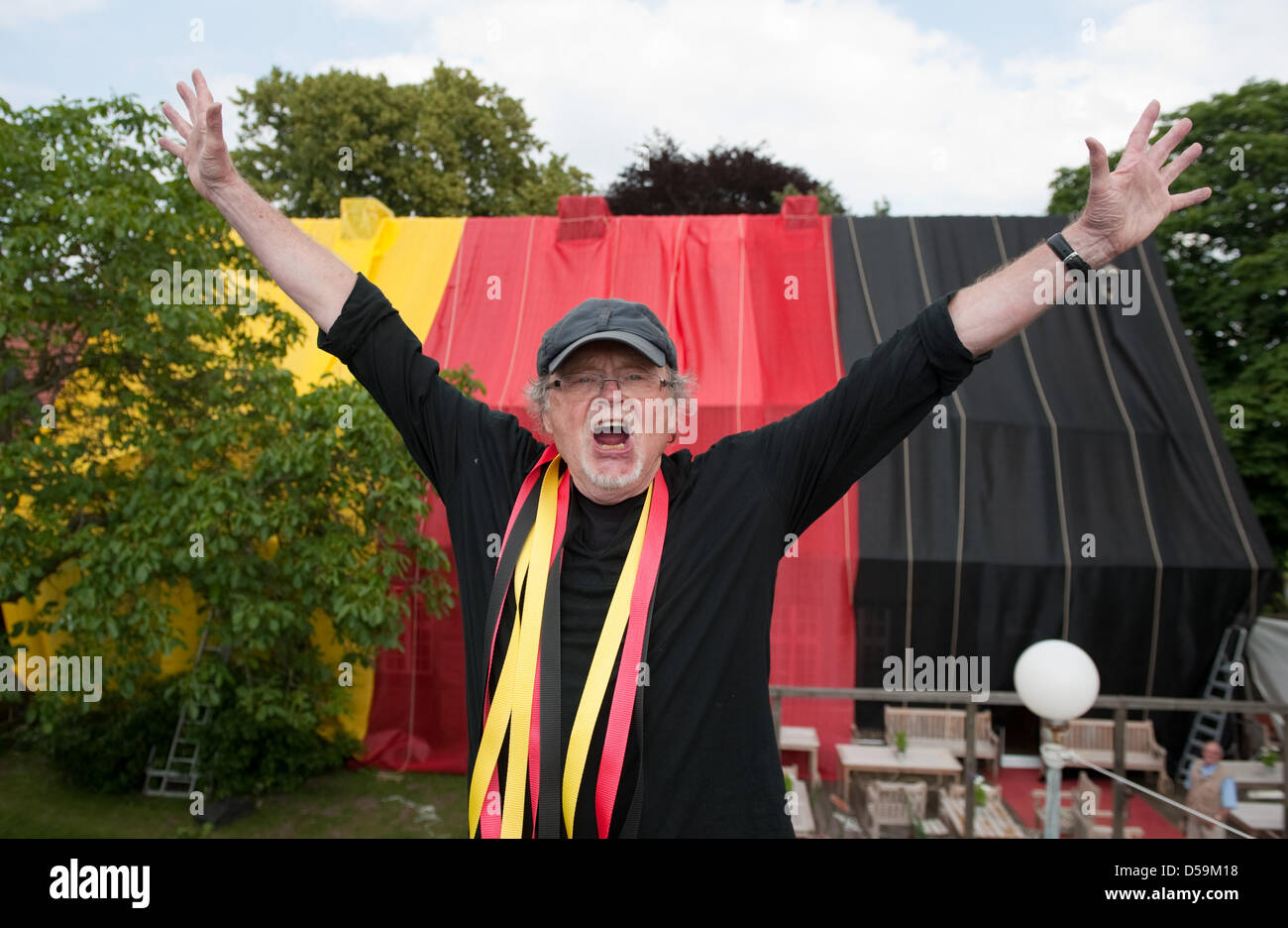 Sixty-nine-year-old salesman, art collector and soccer enthusiast Hans Schalueck poses in front of his wrapped house - Stock Image