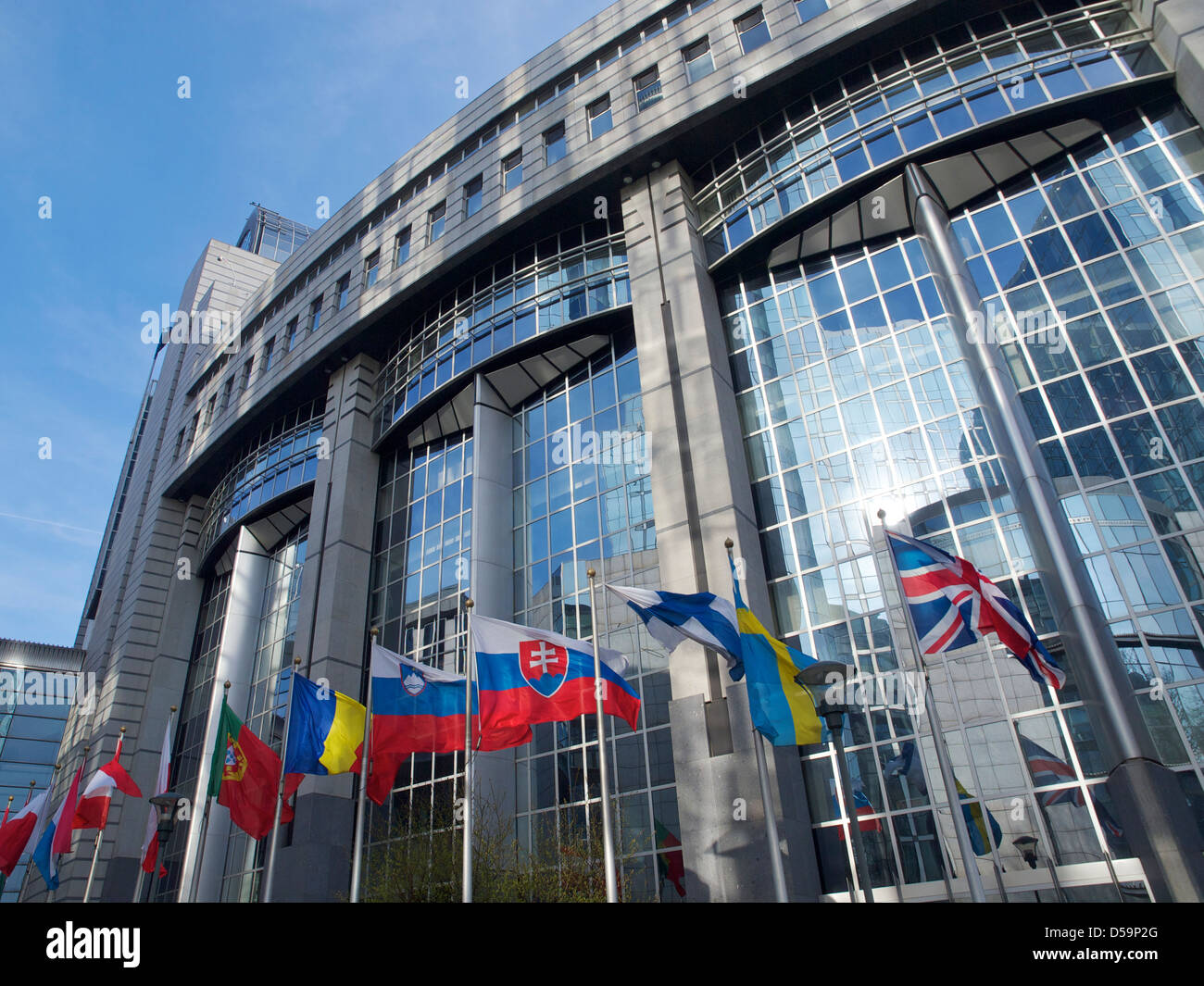 various national flags at the European Parliament building in Brussels, Belgium - Stock Image
