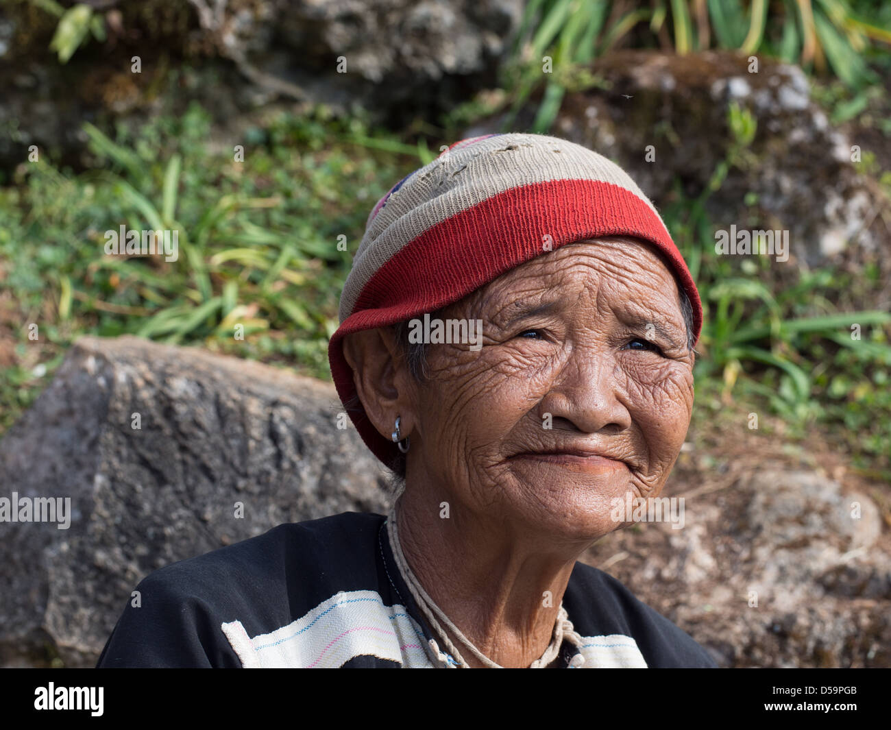 An Old Thai Woman with a wrinkled face from Doi Angkhan, Northern Thailand - Stock Image
