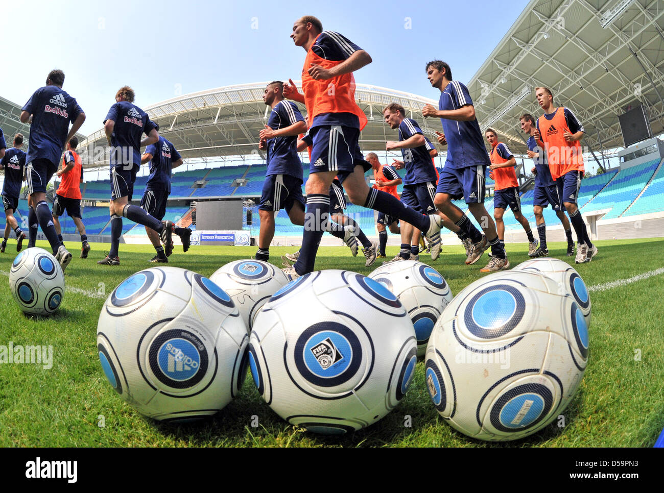 Players of the RB Leipzig, new to the regional league, kick off training at the Central Stadium in Leipzig, Germany, - Stock Image