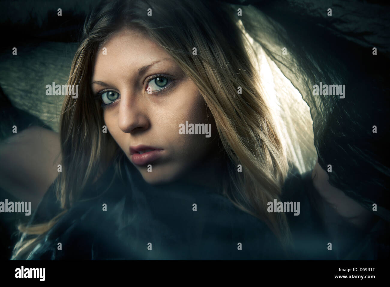 Blond woman girl scarf over head fashion portrait - Stock Image