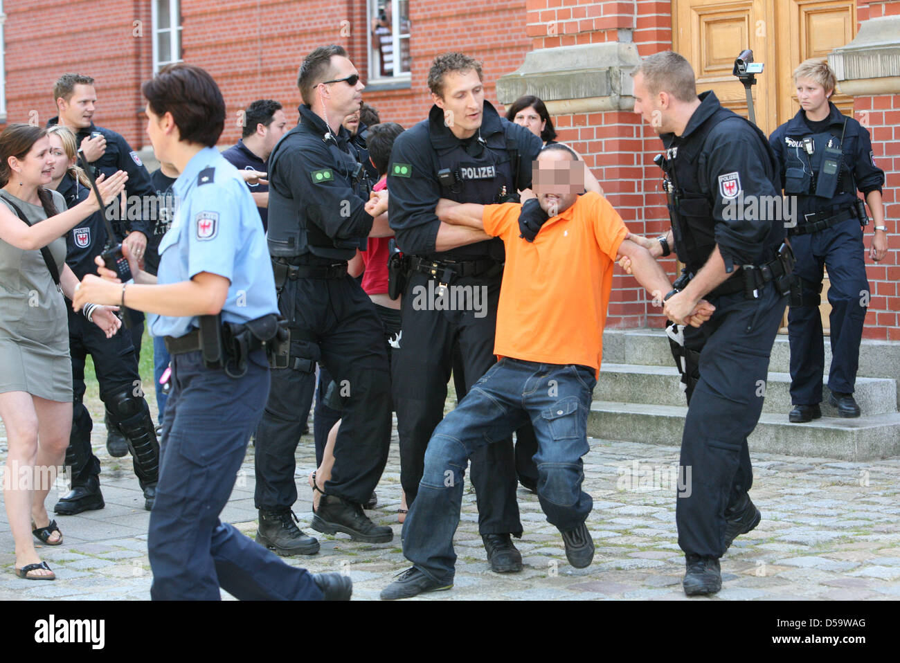 After the the sentencing of thre plainclothesmen at the state court, an incident occurred in Neuruppin, Germany, - Stock Image