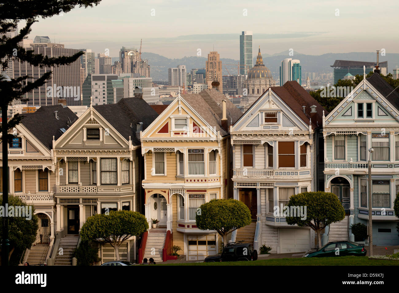 Victorian houses Painted Ladies at Alamo Square and the Skyline of San Francisco, California, United States of America, - Stock Image