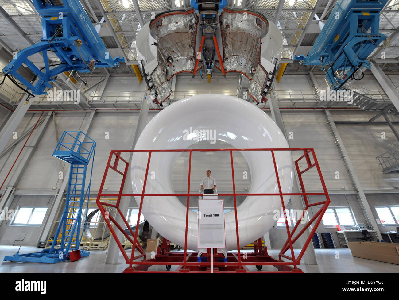 Works on the cover panel of a Rolls-Royce Trent 900 jet engine at the 'N3 Overhaul Services GmbH'  jet engine maintenance Stock Photo