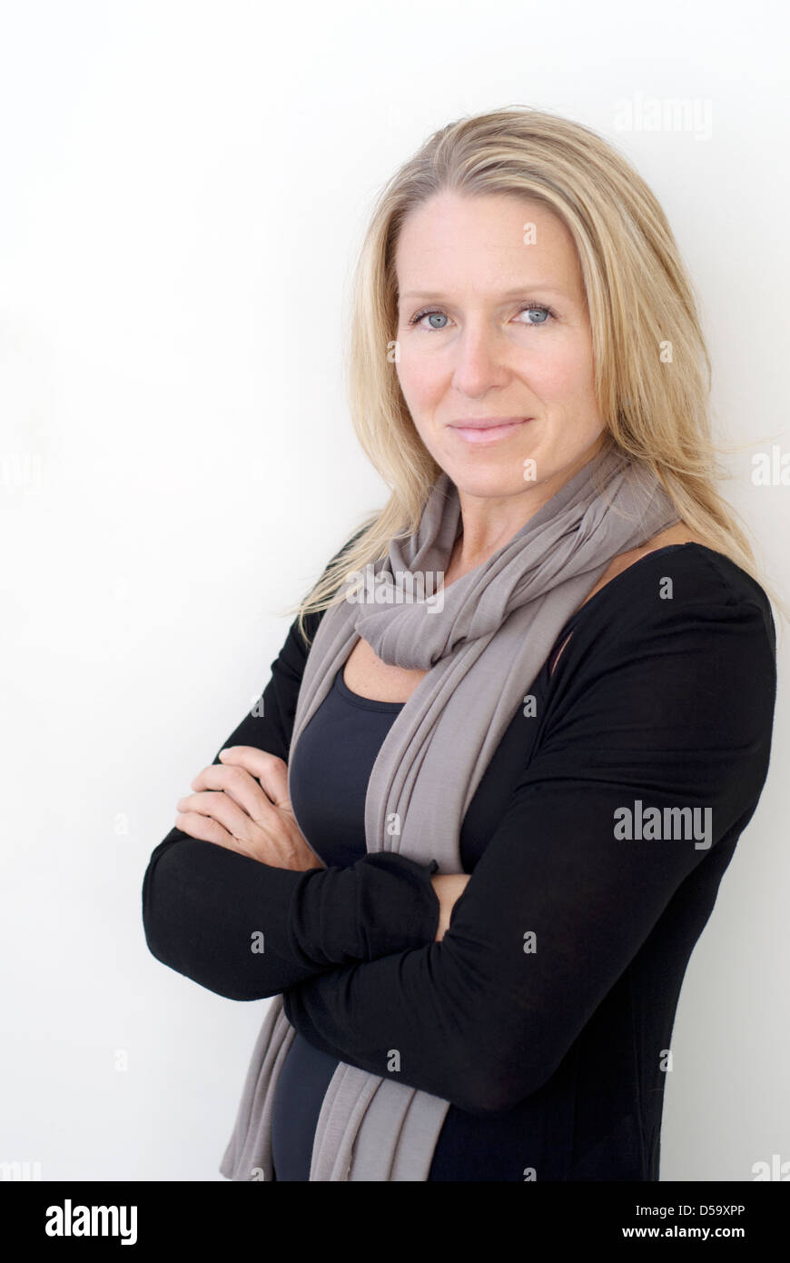 Business style portrait of pretty confident appearing woman in 40's - Stock Image