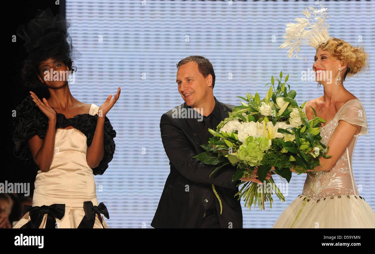 Models applaud the Designer Guido Maria Kretschmer after a show of the label  Guido Maria Kretschmer 72ba5d0d81