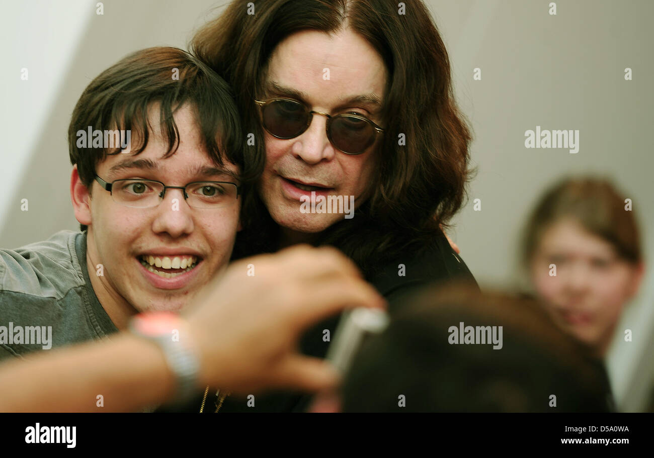 Rockstar Ozzy Osbourne allows fans to take photos with him during an autograph session in Berlin, Germany, 8 July Stock Photo