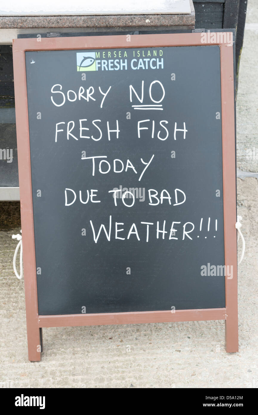 Sorry no fish today due to bad weather sign at a fish shop at West Mersea Colchester UK - Stock Image