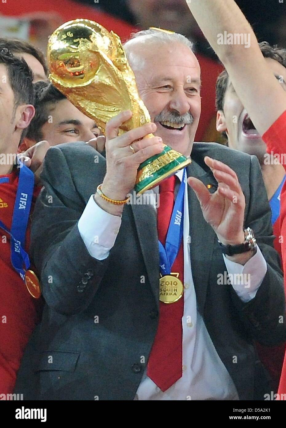 Spain S Coach Vicente Del Bosque C Lifts The World Cup Trophy After The 2010 Fifa World Cup Final Match Between The Netherlands And Spain At Soccer City Stadium In Johannesburg South Africa