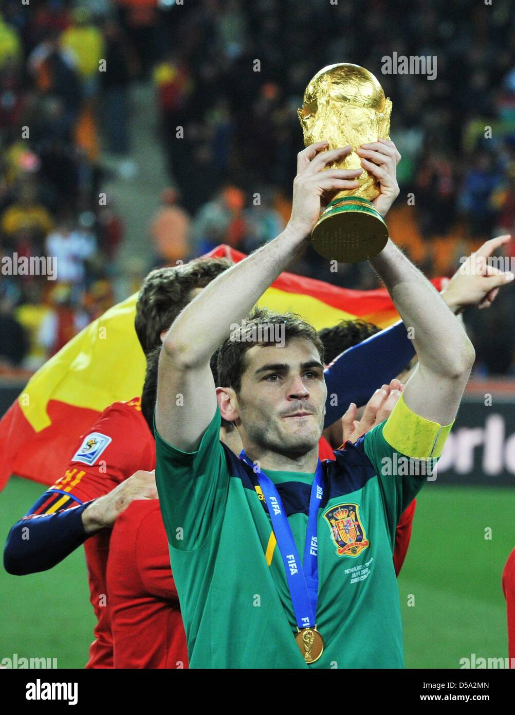 97009c4fe7e Goalkeeper Iker Casillas of Spain celebrates with the trophy after the 2010  FIFA World Cup final
