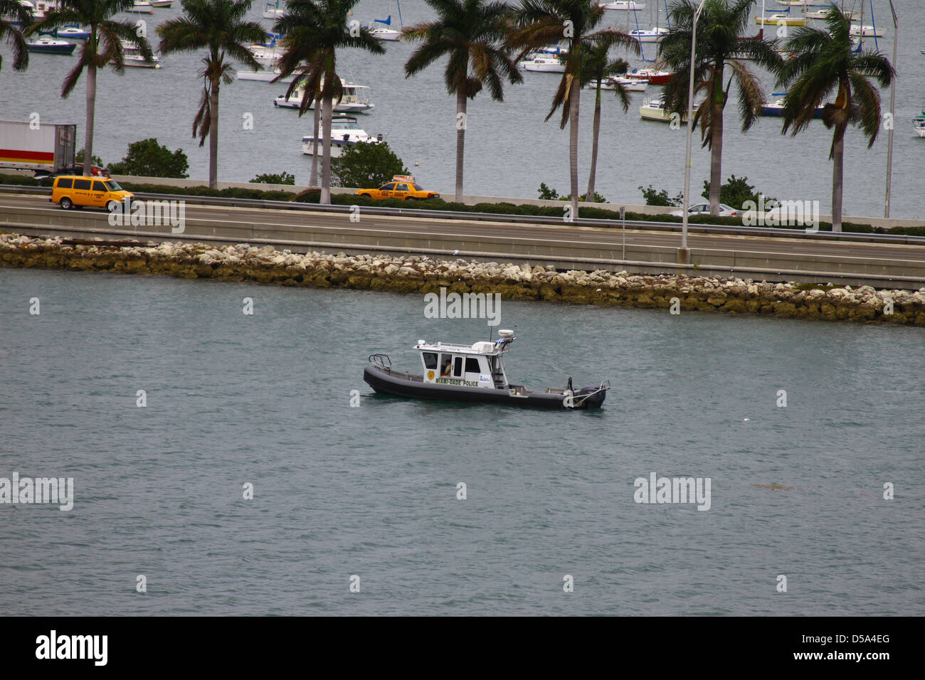 A Miami-Dade Police boat patrolling the waters near the Port of Miami. - Stock Image