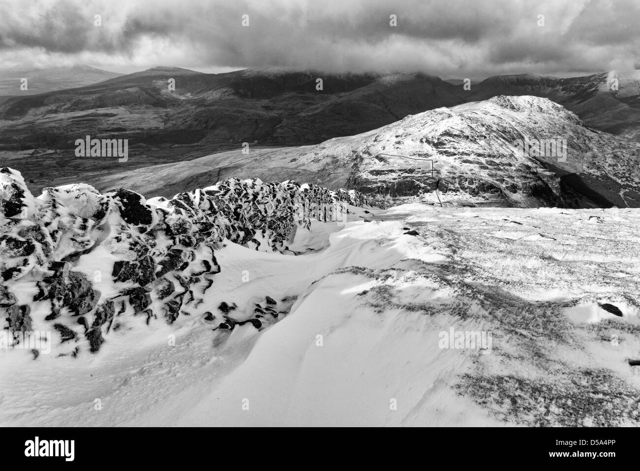 A snowy wall on Moel Hebog in black and white Stock Photo