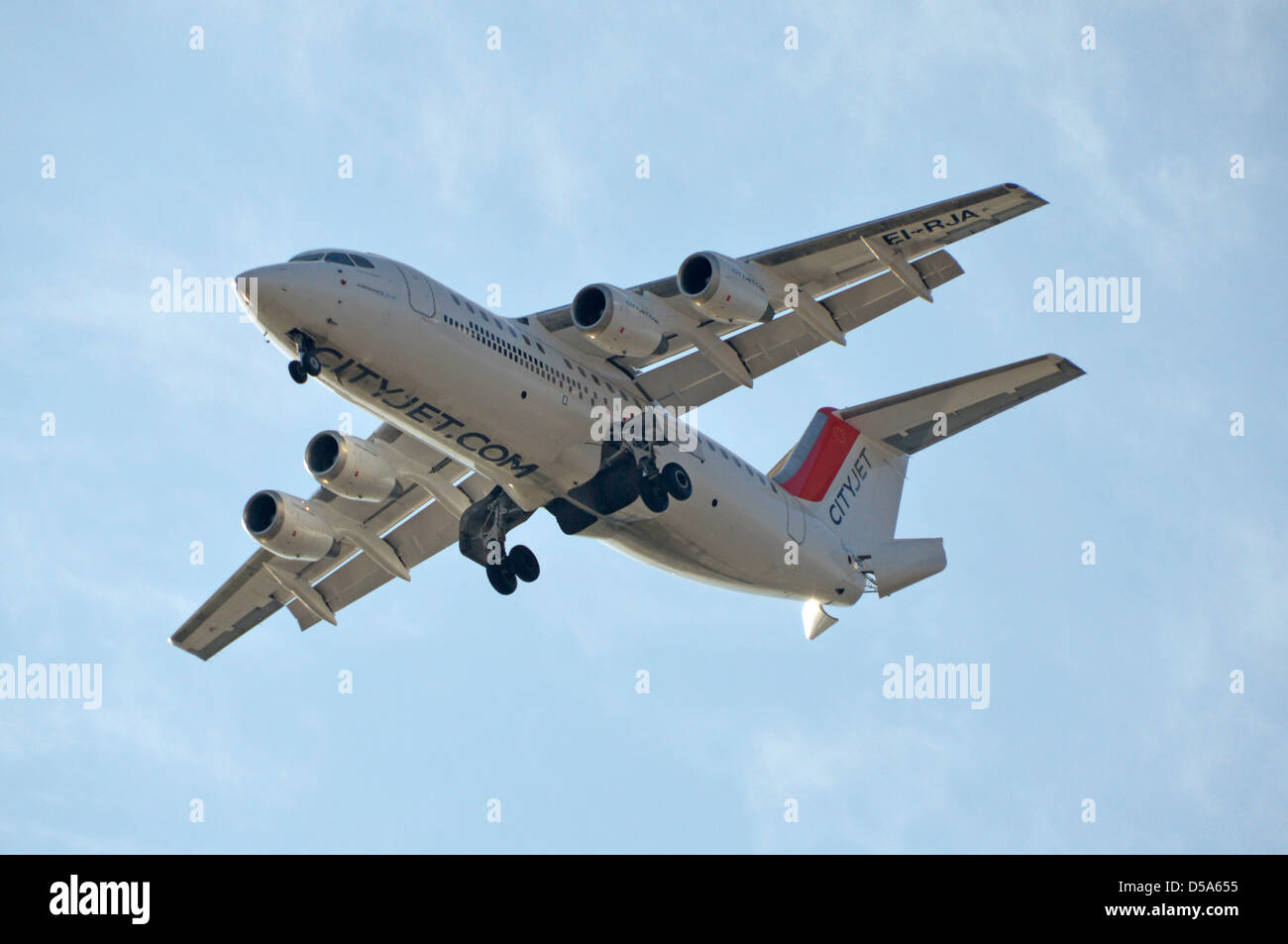 Cityjet British Aerospace Avro RJ85 four engine passenger jet aircraft climbing after takeoff - Stock Image