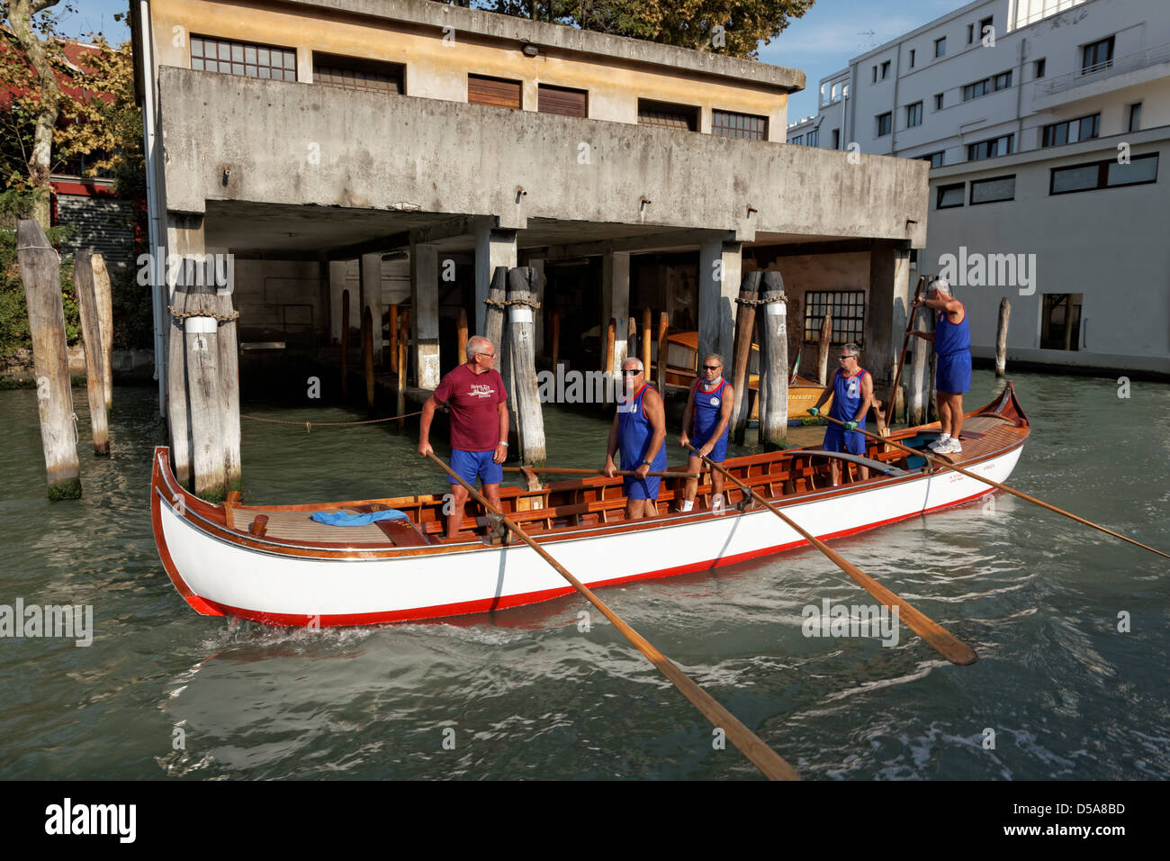 Traditional Venetian rowing boat on the Grand Canal in Venice.  This type of boat, called a 'Caorlina' - Stock Image