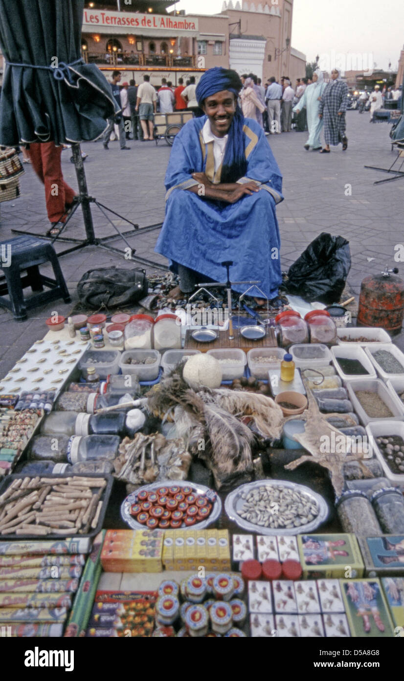 A berber or touareg desert man plies his wares in the djemaa el Fna, Marrakesh - Stock Image