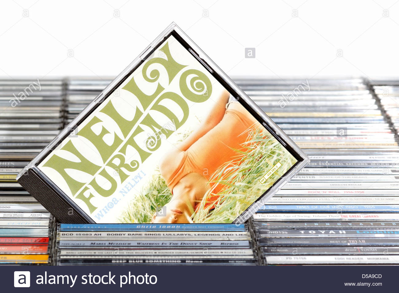 Nelly Furtado album, Whoa Nelly piled music CD cases, England. Stock Photo