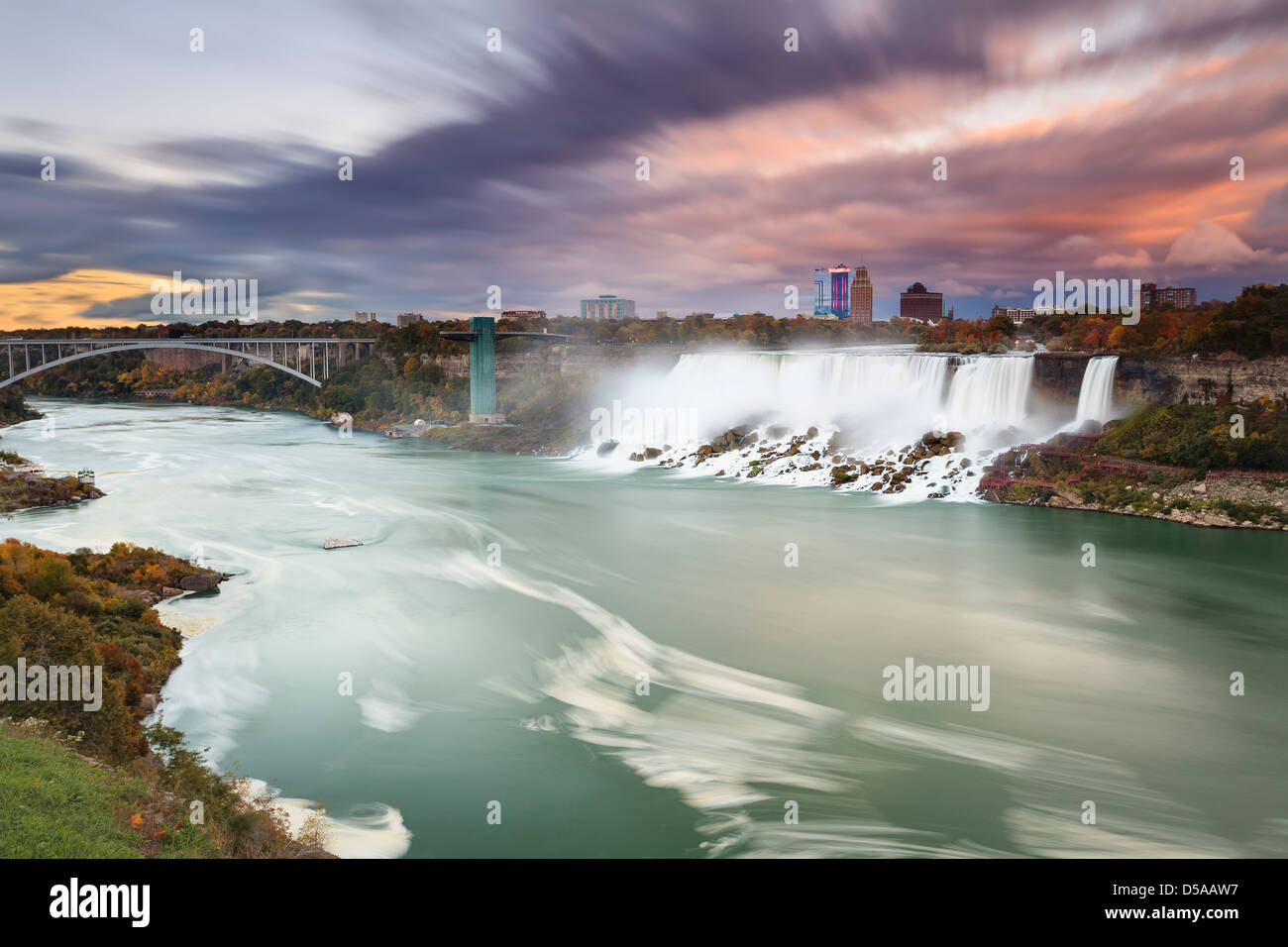 Niagara River with American Falls and Rainbow Bridge, Niagara Falls, New York, USA - Stock Image