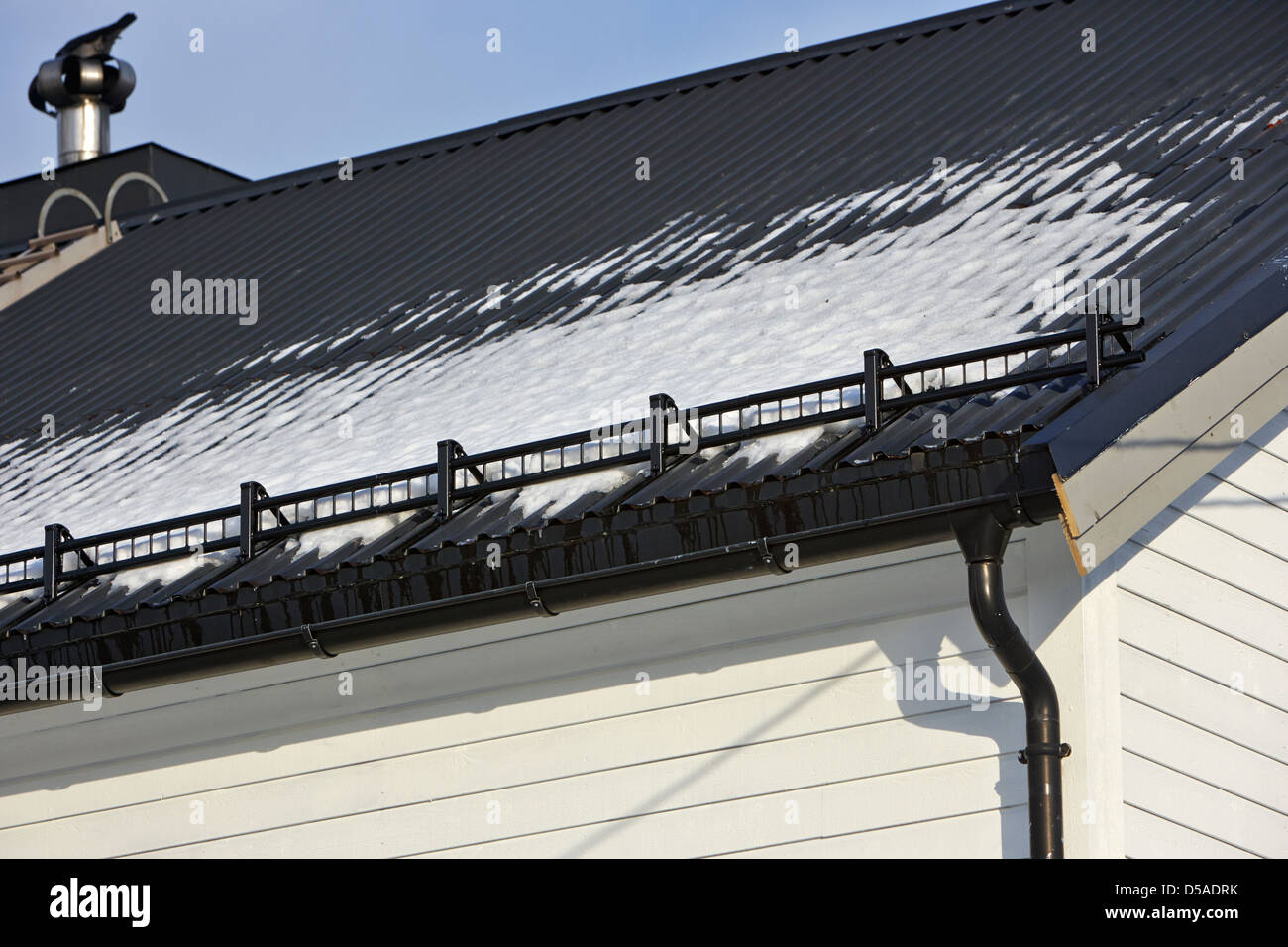 snow retention system guard on roof in kirkenes finnmark norway europe - Stock Image