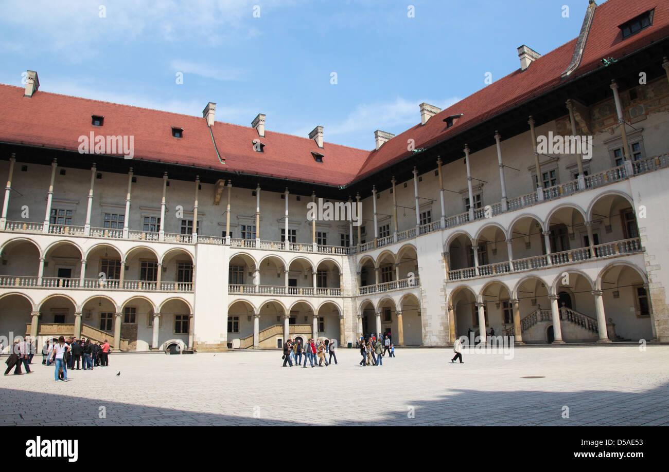 Unidentified people in the courtyard of Wawel Castle on Wawel Hill in Krakow, Poland on April, 26, 2011. - Stock Image