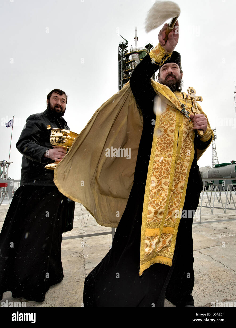 A Russian Orthodox priest blesses members of the media shortly after blessing the Soyuz rocket at the Baikonur Cosmodrome Stock Photo