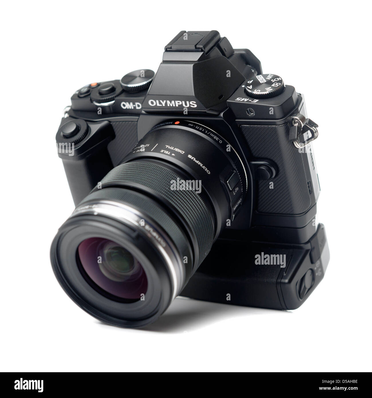 Olympus OM-D E-M5 digital mirrorless camera with HLD-6 battery grip and Zuiko 12-50mm f/3.5-5.6 zoom lens - Stock Image
