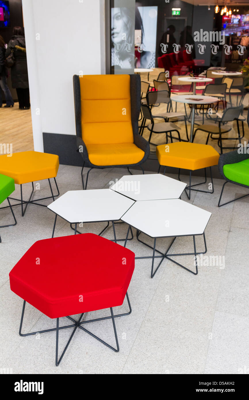 Novel café furniture outside a store in the Trinity Retail Development in Leeds - Stock Image