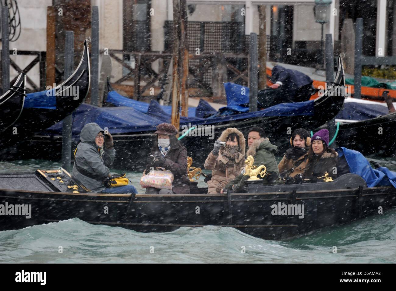 Japanese tourists Venice Italy gondolier winter Stock Photo