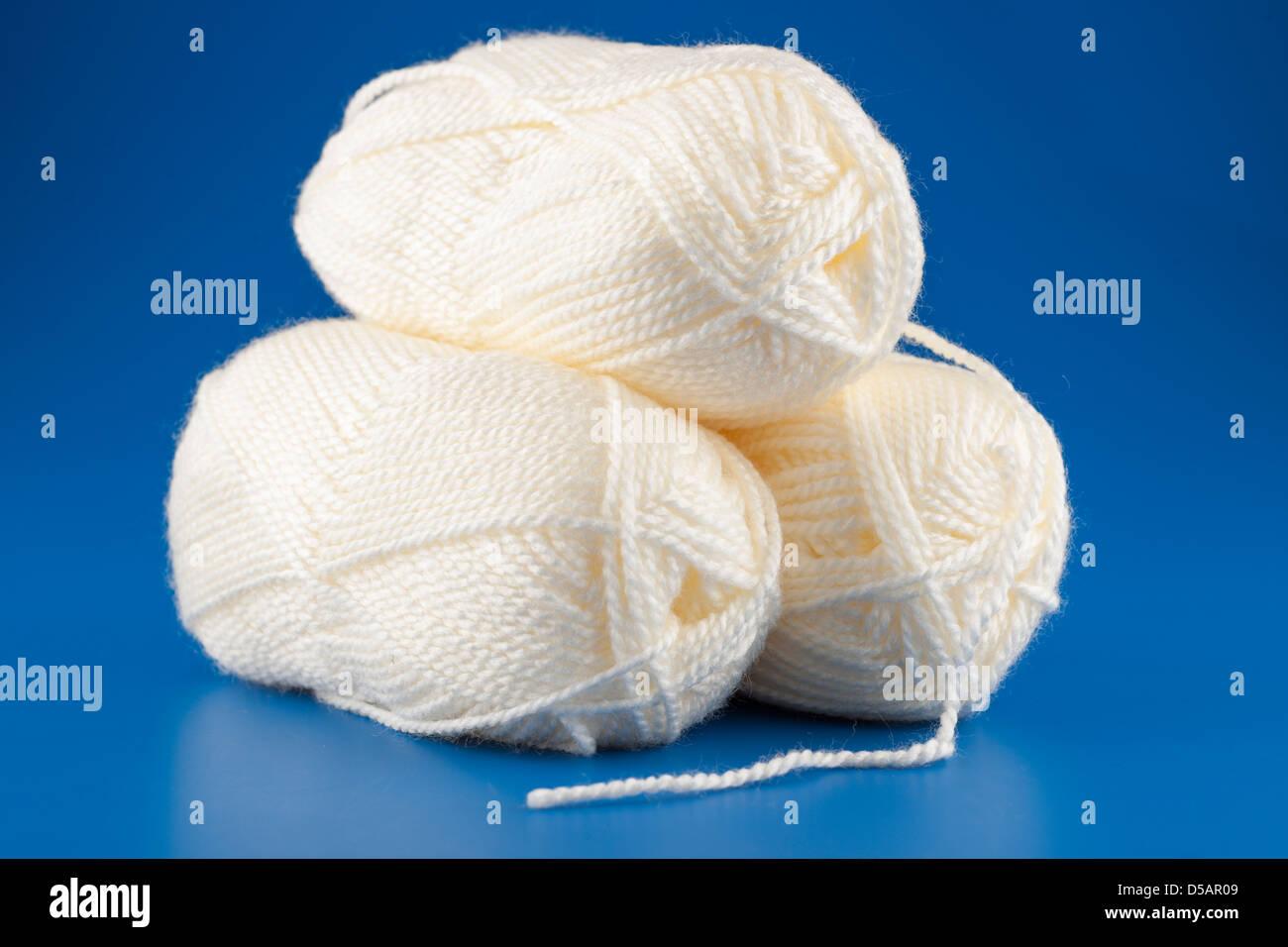 Three balls of 100 gram premium acrylic cream coloured wool - Stock Image