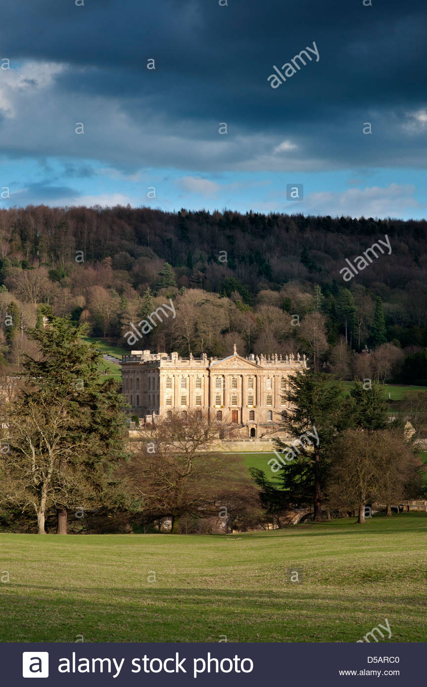 View of Chatsworth House under stormy skies, Derbyshire. - Stock Image