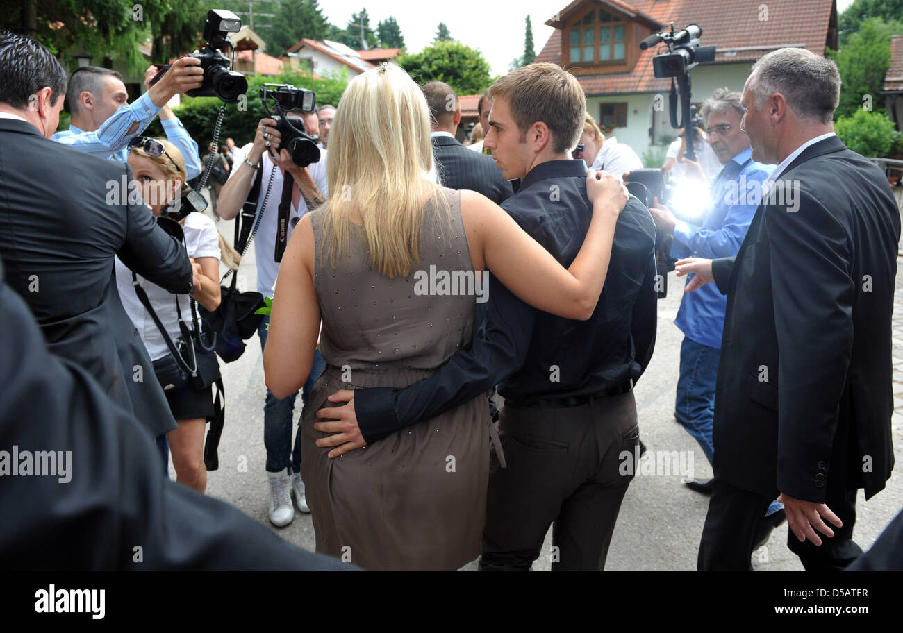 Germany International Philipp Lahm And His Wife Claudia Leave Their
