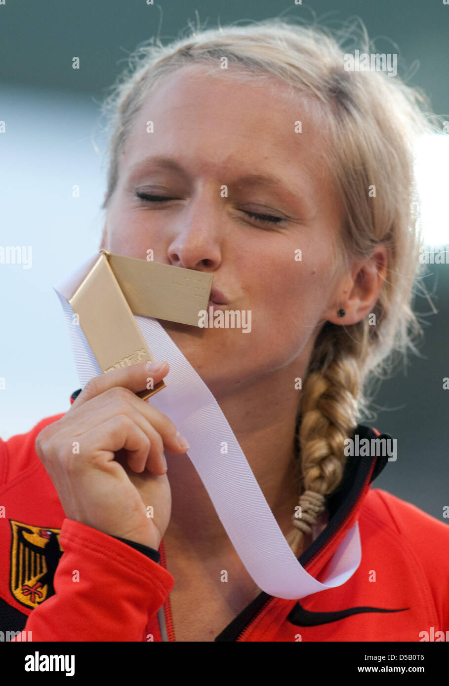 The German sprints gold medalist Verena Sailer kisses her medal for her victory in the 100-metre sprints at the - Stock Image