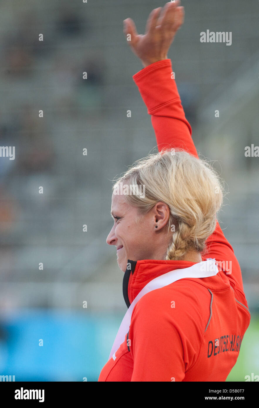 The German sprints gold medalist Verena Sailer presents her medal for her victory in the 100-metre sprints at the - Stock Image