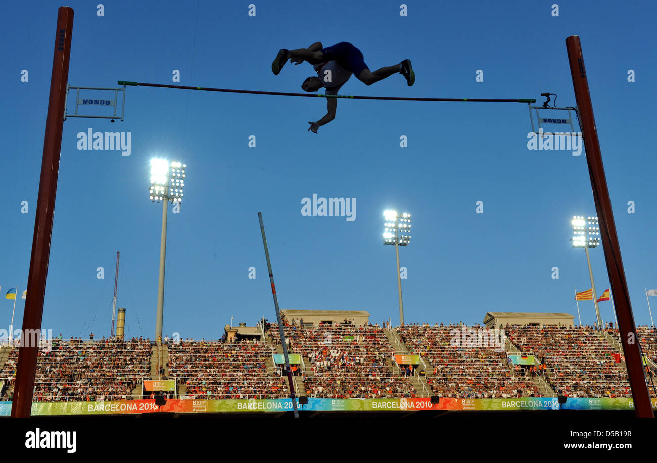 The French pole jumper Renaud Lavillenie jumps during the European Athletics Championships at Olympic stadium Lluis - Stock Image