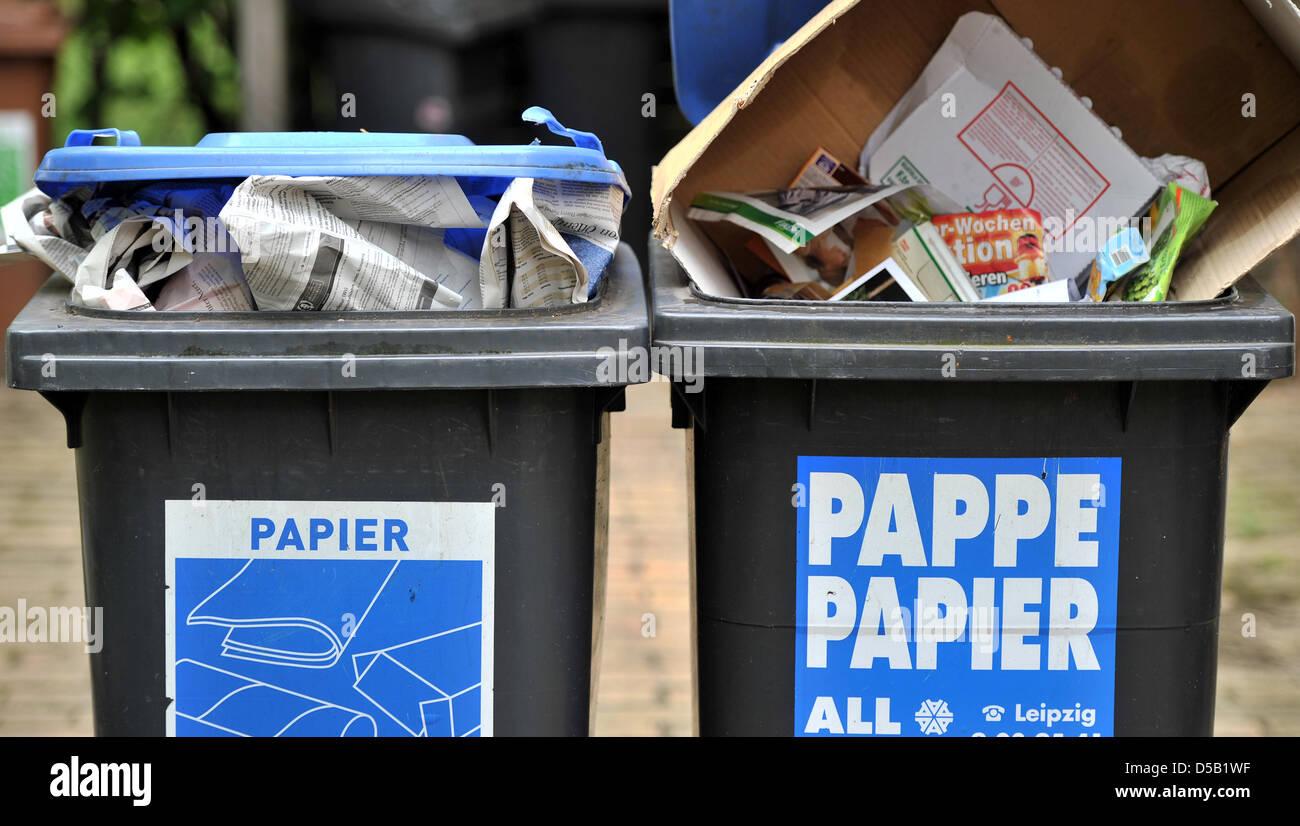 Backyard Bins paper recycling bins stand in a backyard in leipzig, germany, 2