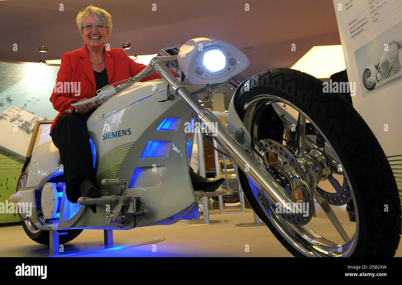 German Minister of Education Annette Schavan (CDU) sits on an electric motorcycle during a youth congress concerning - Stock Image